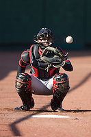Catcher A.J. Jimenez #6 of the Lansing Lugnuts warms up the starting pitcher in the bullpen at Coveleski Stadium April 15, 2009 in South Bend, Indiana. (Photo by Brian Westerholt / Four Seam Images)