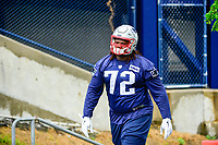June 6, 2017: New England Patriots defensive tackle Josh Augusta (72) walks to practice in the rain at the New England Patriots mini camp held on the practice field at Gillette Stadium, in Foxborough, Massachusetts. Eric Canha/CSM