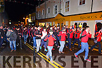 Pobalscoil Chorca Dhuibhne players escorted by the Dingle Drum and Fife Band around the streets of Dingle after winning the Hogan Cup on Saturday night.