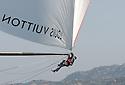 Louis Vuitton Trophy La Maddalena 28 maggio 2010. Il prodiere di BMW Oracle impegnato in una manovra sul tangone durante una regata con i russi di Synergy Russian Sailing Team.