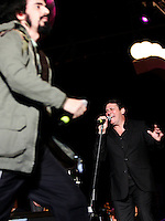 Il cantante degli Spandau Ballet Tony Hadley canta col cantautore rap CapaRezza sul palco del tradizionale concerto del Primo Maggio organizzato da Cgil, Cisl e Uil in piazza San Giovanni, Roma, 1 maggio 2011..Spandau Ballet's frontman Tony Hadley and Italian rapper CapaRezza, left, perform on stage in St. John in Lateran's Square, Rome, 1 may 2011, during the traditional May Day concert..UPDATE IMAGES PRESS/Riccardo De Luca