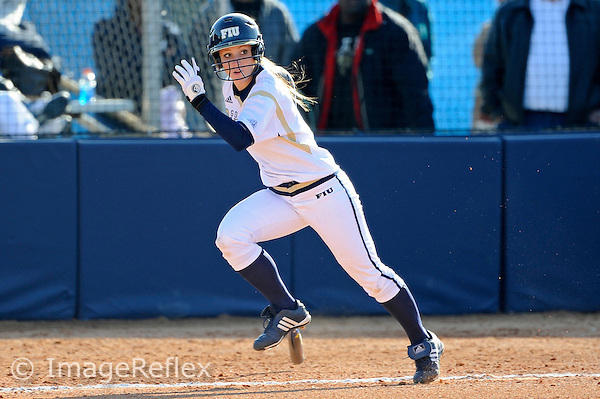 13 February 2010:  FIU's Beth Peller (9) runs to first as the FIU Golden Panthers defeated the University of Illinois (Chicago) Flames, 2-1, at the University Park Stadium in Miami, Florida.