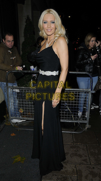 Emma Noble.The Amy Winehouse Foundation Ball, Dorchester Hotel, Park Lane, London, England..November 20th, 2012.full length black dress slit split silver belt side  .CAP/CAN.©Can Nguyen/Capital Pictures.