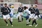 Luis Swisher (4), of Guatemala plays the ball between the United States' Brian Ching (11) and Chris Rolfe (7) on Sunday, February 19th, 2005 at Pizza Hut Park in Frisco, Texas. The United States Men's National Team defeated Guatemala 4-0 in a men's international friendly.