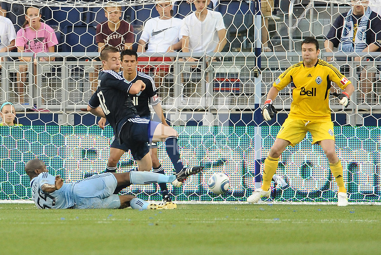 Julio Cesar (light blue, on floor) scores the game winning goal for Sporting KC... Sporting KC defeated Vancouver Whitecaps 2-1 at LIVESTRONG Sporting Park, Kansas City, Kanas.