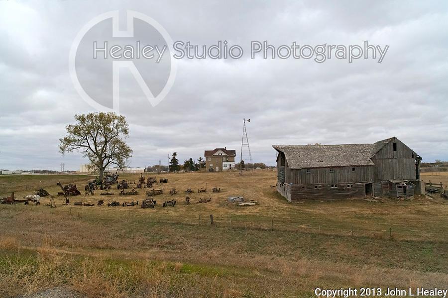 Americana Series: Roadside Views<br /> <br /> Orderly display of farmyard equipment on a roadside farm in South Dakota