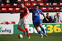 Mat Sadler of Walsall escapes from Lawrie Wilson of Stevenage. - Walsall v Stevenage - npower League 1 - Banks's Stadium, Walsall - 24th March, 2012  .© Kevin Coleman 2012