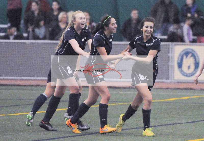 From left, Eagle Rivers' Makinna Olmsead,  Jessie Scott and Allison Jimenez celebrate Scott's winning goal during the Wolves' 3-2 win over East at The Dome Monday January 4, 2016.  Photo for the Star by Michael Dinneen