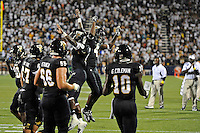 1 September 2011:  FIU running back Kedrick Rhodes (9) and wide receiver T.Y. Hilton (4) celebrate Rhodes' second touchdown in the first quarter as the FIU Golden Panthers defeated the University of North Texas, 41-16, at FIU Stadium in Miami, Florida.