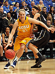SIOUX FALLS, SD - MARCH 9:  Leah Dietel #21 from South Dakota State University drives past Elizabeth Hamlet #33 from Oakland University in the first half of their game at the Sioux Falls Arena during the 2013 Summit League Tournament Saturday afternoon. (Photo by Dave Eggen/Inertia)