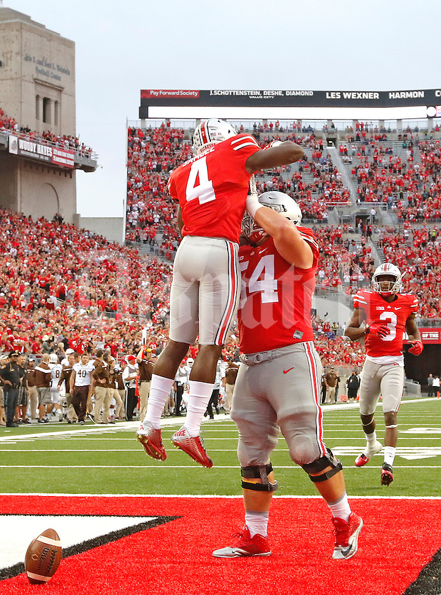 Ohio State Buckeyes running back Curtis Samuel (4) celebrates his fourth quarter with Ohio State Buckeyes offensive lineman Billy Price (54) at Ohio Stadium on September 26, 2015. (Chris Russell/Dispatch Photo)