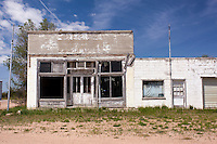 Old abandoned store and post office building in Lamar, NE