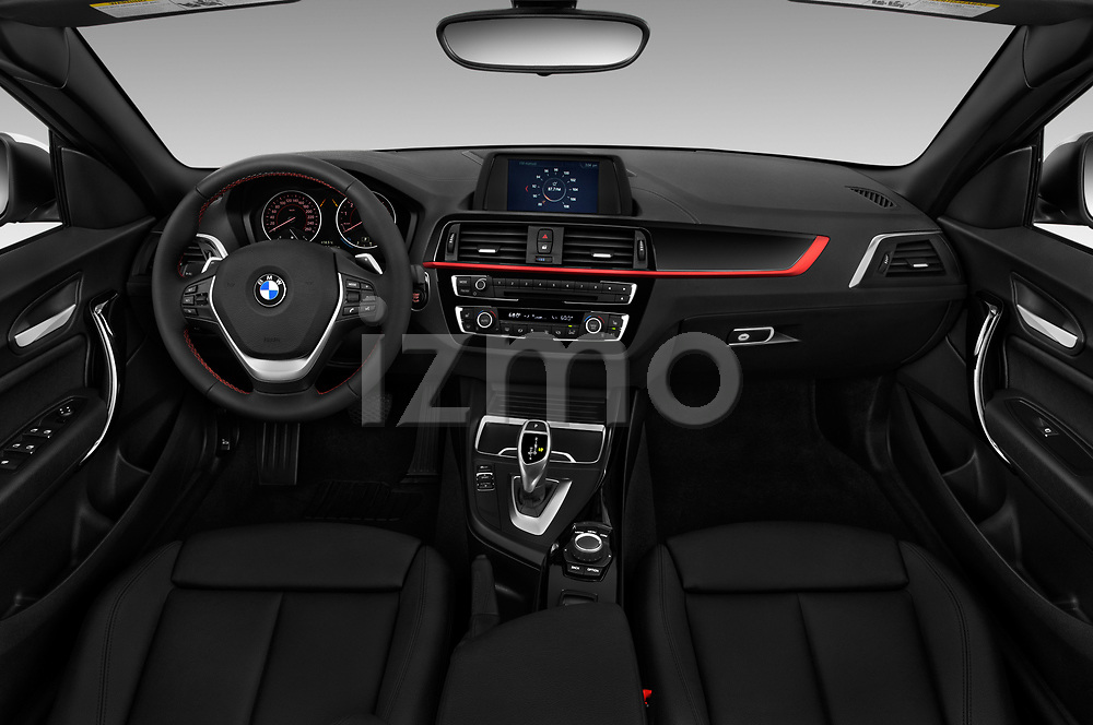 Stock photo of straight dashboard view of a 2018 BMW 2 Series Sport 2 Door Convertible