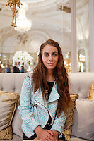 Diana Basfam, student at the International University of Monaco, poses for the photographer in the lobby of l'Hotel de Paris, Casino Square, Monte Carlo, Monaco, 19 April 2013. She is a regular visitor to l'Hotel de Paris and comes to the lobby or terrace to study from time to time.