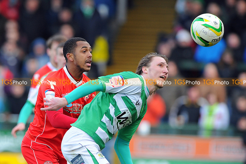 Luke Ayling of Yeovil Town and Ashley Hemmings of Walsall go for th ball - Yeovil Town vs Walsall - NPower League One Football at Huish Park, Yeovil, Somerset - 29/03/13 - MANDATORY CREDIT: Denis Murphy/TGSPHOTO - Self billing applies where appropriate - 0845 094 6026 - contact@tgsphoto.co.uk - NO UNPAID USE.