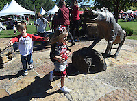 NWA Democrat-Gazette/MICHAEL WOODS &bull; @NWAMICHAELW<br /> Hudson Irons and his twin sister Haven Irons, age 4, from Alma, play around at the Razorback statue at the Gardens Saturday , October, 8, 2016 while tailgating with their family before the start of the Arkansas Alabama football game in Fayetteville.