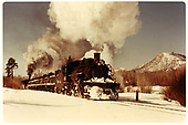 #483 leaving Chama with tank cars.  Snow on ground.<br /> D&amp;RGW  Chama, NM  3/14/1963