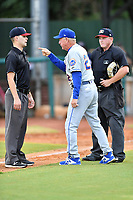 Kingsport Mets manager Rich Donnelly (22) makes his point to umpire Kaleb Devier as home plate umpire Zachary Robbins watches on during a game against the Elizabethton Twins at Joe O'Brien Field on July 6, 2019 in Elizabethton, Tennessee. The Twins defeated the Mets 5-3. (Tony Farlow/Four Seam Images)