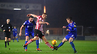 Lincoln City's Harry Anderson vies for possession with Morecambe's Luke Conlan<br /> <br /> Photographer Chris Vaughan/CameraSport<br /> <br /> The EFL Sky Bet League Two - Saturday 15th December 2018 - Lincoln City v Morecambe - Sincil Bank - Lincoln<br /> <br /> World Copyright © 2018 CameraSport. All rights reserved. 43 Linden Ave. Countesthorpe. Leicester. England. LE8 5PG - Tel: +44 (0) 116 277 4147 - admin@camerasport.com - www.camerasport.com