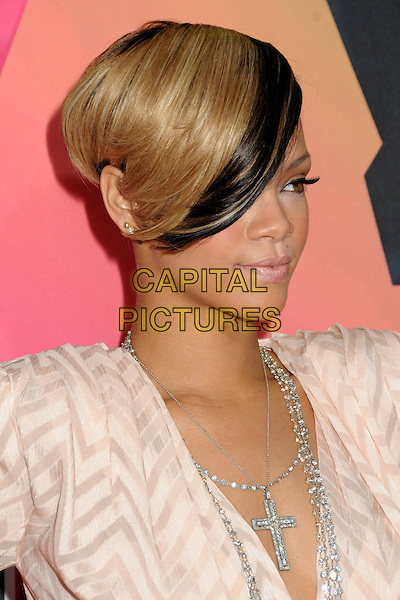 RIHANNA (Robyn Rihanna Fenty) .at the 23rd Annual Nickelodeon Kids' Choice Awards 2010 held at Pauley Pavilion in Westwood, California, USA, March 27th 2010 .arrivals kids portrait headshot earrings cream beige nude patterned pattern cross silver necklace diamante hair dyed shaved head necklaces blonde side profile .CAP/ADM/BP.©Byron Purvis/Admedia/Capital Pictures