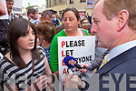 Enda Kenny is confronted by Rachel Sheehan from Lauragh and Andrena Brent from Tarbert to protest of the governments plans to cut bus service to rural schools across Ireland.
