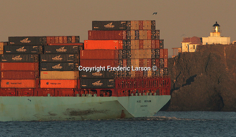 A fully loaded super tanker ship as seen from Fort Baker Beach passing by Point Bonita off the San Francisco Bay.