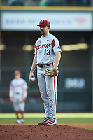 Arkansas Razorbacks starting pitcher Connor Noland (13) during the game against the Oklahoma Sooners in game two of the 2020 Shriners Hospitals for Children College Classic at Minute Maid Park on February 28, 2020 in Houston, Texas. The Sooners defeated the Razorbacks 6-3. (Brian Westerholt/Four Seam Images)