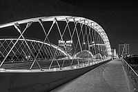 We capture this black and white of the Seventh Street bridge in Fort Worth Texas at night as the lights of the city came on. Fort Worth recently added this modern architecture urban bridge which connects the university area of the city with the downtown area. The bridge crosses over the Trinity river in downtown. The close up view of the bridge framed the the cityscape at night very nicely. Fort Worth is the fifth largest city in Texas and it is growing quickly. In the past the city was known as a cow town because it was once part of the Chisholm trail cattle drives and had a rough tough brawling wild west place. It still imbraces it western heritage but has grow
