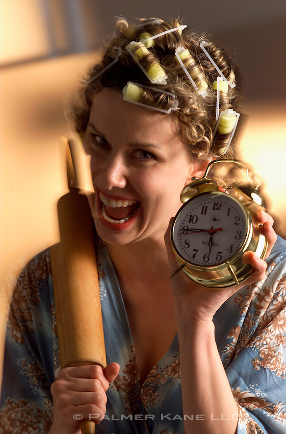 angry wife finally catches late arriving husband; shows him both a rolling pin and an alarm clock