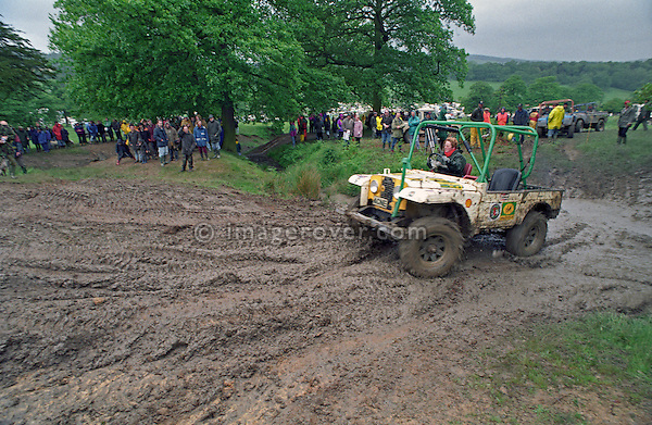 Woman competing with a Land Rover Series 1 based off-road racer at the1993 A.R.C. National Rally. The Association of Rover Clubs (A.R.C., since 2006 the Association of Land Rover Clubs ALRC) National Rally is the biggest annual motor sport oriented Land Rover event and was hosted 1993 by the Midland Rover Owners Club at Eastnor Castle in Herefordshire. --- No releases available. Automotive trademarks are the property of the trademark holder, authorization may be needed for some uses.