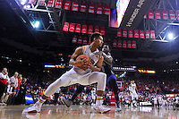 Melo Trimble shields the ball from a defender. Maryland defeated Georgetown 75-71 during a game at Xfinity Center in College Park, MD on Wednesday, November 17, 2015.  Alan P. Santos/DC Sports Box