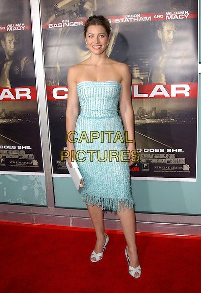 "JESSICA BIEL.New Line Cinema's World Premiere of ""Cellular"" held at The Cinerama Dome in Hollywood, California .September 9, 2004.full length, turquoise, aqua strapless dress, white handbag, clutch purse, tassles.www.capitalpictures.com.sales@capitalpictures.com.Copyright by Debbie VanStory."