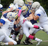 Bensalem's Drasaune Moore (11) is crushed by Council Rock South defenders as he pushes forward with the ball in the first quarter at Council Rock North Saturday October 8, 2016 in Newtown, Pennsylvania. (Photo by William Thomas Cain)