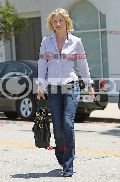 Ali Larter looked great with fresh and flowing hair while leaving the Byron Tracey hair salon in Beverly Hills. Ali wore a casual button up pin stripe shirt with flare jeans, a slim cheetah print belt and a large Balenciaga tote. Los Angeles, California on 09.05.2012.Credit: Vida/face to face /MediaPunch Inc. ***FOR USA ONLY***