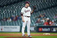 Mississippi State Bulldogs relief pitcher Blake Smith (42) looks to his catcher for the sign against the Houston Cougars in game six of the 2018 Shriners Hospitals for Children College Classic at Minute Maid Park on March 3, 2018 in Houston, Texas. The Bulldogs defeated the Cougars 3-2 in 12 innings. (Brian Westerholt/Four Seam Images)