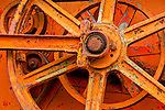 The rusting wheel of a trasher left in a farm field in Santa Barbara County, CA.