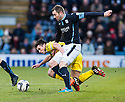 Dundee's Kevin Thomson is grabbed by St Mirren's John McGinn.