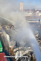 63818-02406 Firefighters extinguishing warehouse fire using aerial ladder truck viewed from top of ladder, Salem, IL