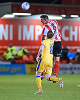 Lincoln City's Matt Rhead gets above Chester's Tom Shaw to win a header<br /> <br /> Photographer Andrew Vaughan/CameraSport<br /> <br /> Vanarama National League - Lincoln City v Chester - Tuesday 11th April 2017 - Sincil Bank - Lincoln<br /> <br /> World Copyright &copy; 2017 CameraSport. All rights reserved. 43 Linden Ave. Countesthorpe. Leicester. England. LE8 5PG - Tel: +44 (0) 116 277 4147 - admin@camerasport.com - www.camerasport.com
