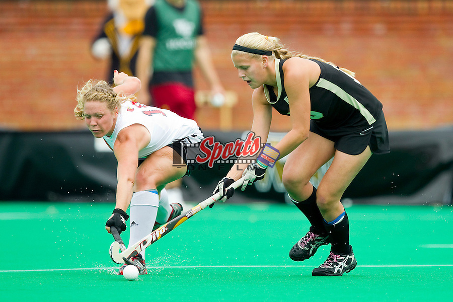 Krysta Wangerin (15) of the Wake Forest Demon Deacons tries to keep the ball away from Alyssa Voelmle (10) of the Louisville Cardinals at Kentner Stadium on October 14, 2012 in Winston-Salem, North Carolina.  The Cardinals defeated the Demon Deacons 2-1.  (Brian Westerholt/Sports On Film)