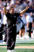 OAKLAND, CA - Head coach Joe Bugel of the Oakland Raiders walks the sidelines during a game against the St. Louis Rams at the Oakland Coliseum in Oakland, California in 1997. Photo by Brad Mangin