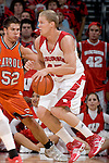 MADISON, WI - NOVEMBER 8: Forward Joe Krabbenhoft #45 of the Wisconsin Badgers handles the ball against the Carroll College Pioneers at the Kohl Center on November 8, 2006 in Madison, Wisconsin. The Badgers beat the Pioneers 81-61. (Photo by David Stluka)