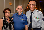 """WATERBURY, CT. 23 May 2018-052318BS93 -From left, Judy Michalski of Southington, Former USS Roosevelt Submariner, Bruce Brayton of Southington, and Air Force veteran Dominic Rinaldi of Waterbury enjoy themselves at the Waterbury Veterans Committee's """"Support Our Troops"""" Annual Dinner at the Ponte Club on Wednesday evening. Bill Shettle Republican-American"""