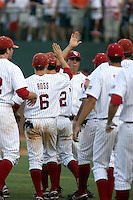 The Oklahoma Sooners celebrate after winning Game Two of the NCAA Super Regional tournament against the Virginia Cavaliers at Charlottesville, VA - 06/13/2010. Oklahoma defeated Virginia, 10-7, to tie the series after two games.  Photo By Bill Mitchell / Four Seam Images