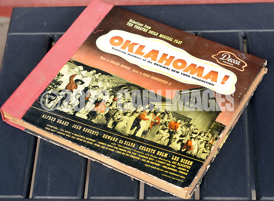 A copy of the original Oklahoma recordings rests on a porch table Friday March 24, 2017 at Highland Farm in Doylestown, Pennsylvania. Hammerstein is in the process of raising money to restore the old brand create a Hammerstein museum dedicated to his grandfather, Oscar Hammerstein, writer of the broadway musicals, Sound of Music, King and I, Oklahoma and Carousel to name a few. (WILLIAM THOMAS CAIN / For The Philadelphia Inquirer)