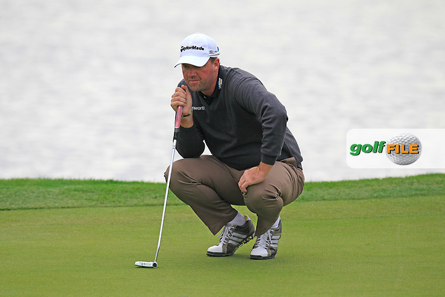 Peter Hanson (SWE) on the 13th green during Friday's Round 2 of the 2013 BMW Masters presented by SRE Group held at Lake Malaren Golf Club, Shanghai, China. 25th October 2013.<br /> Picture: Eoin Clarke/www.golffile.ie