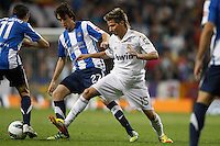24.03.2012 SPAIN -  La Liga matchday 30th  match played between Real Madrid CF vs Real Sociedad (5-1) at Santiago Bernabeu stadium. The picture show Ruben Pardo Gutierrez (Real Sociedad) and  Fabio Alexandre Coentrao (Potuguese defender of  Real Madrid)