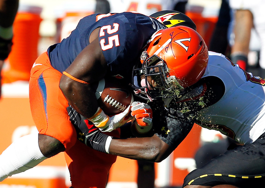 Virginia Cavaliers running back Kevin Parks (25) is hit by Maryland Terrapins defensive back Anthony Nixon (20) causing grass to dislodge from his helmet during the game at Scott Stadium in Charlottesville, VA. Maryland defeated Virginia 27-20.