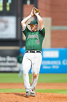 Augusta GreenJackets first baseman Joey Rapp (26) catches a pop fly on the pitchers mound during the South Atlantic League game against the Greensboro Grasshoppers at NewBridge Bank Park on August 11, 2013 in Greensboro, North Carolina.  The GreenJackets defeated the Grasshoppers 6-5 in game one of a double-header.  (Brian Westerholt/Four Seam Images)