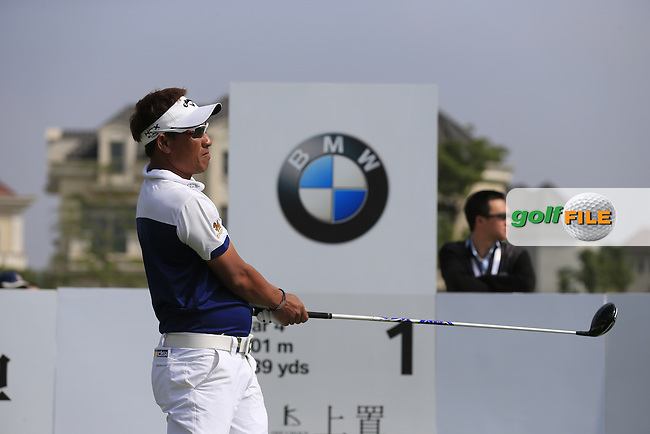 Thongchai Jaidee (THA) tees off the 1st tee to start his match during Saturday's Round 3 of the 2013 BMW Masters presented by SRE Group held at Lake Malaren Golf Club, Shanghai, China. 26th October 2013.<br /> Picture: Eoin Clarke/www.golffile.ie